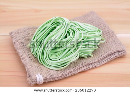 bunches dried green noodle on wooden table  - stock photo