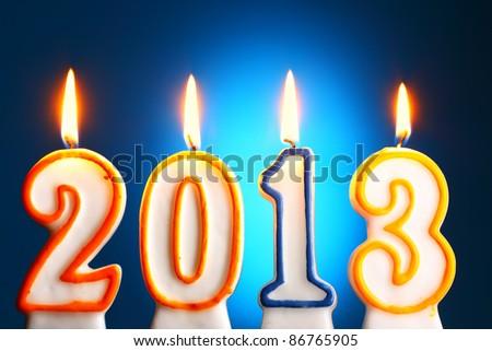 2013 burning candles close-up over blue backgroumd - stock photo