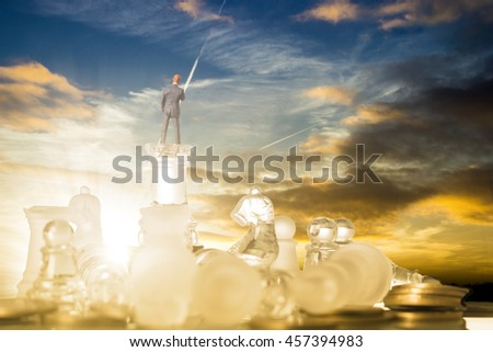 Business competition chess battle strategy game. Businessman stand over a chess after victory. - stock photo