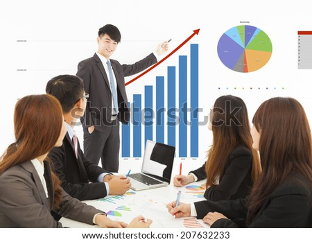 business man giving a presentation about marketing sales - stock photo