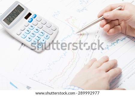 Business man working with stock market data - stock photo