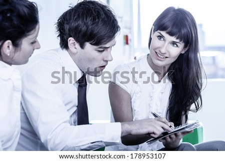 business people discussing their ideas in office low saturation of colours - stock photo