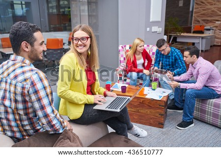 business, startup and people concept - happy creative team talking in office                               - stock photo