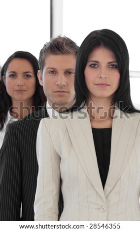 business team with foreground beautiful businesswoman smiling - stock photo