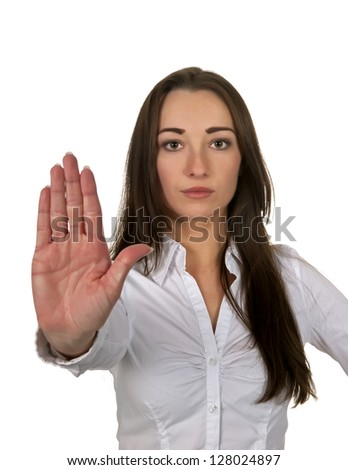 business woman shows stop with one hand - stock photo