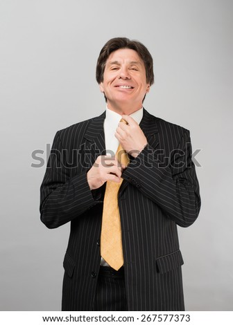 businessman corrects for  tie - stock photo