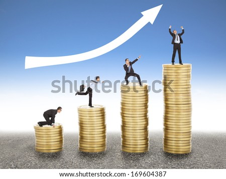 businessman goes up the gold coin, from  start to success - stock photo