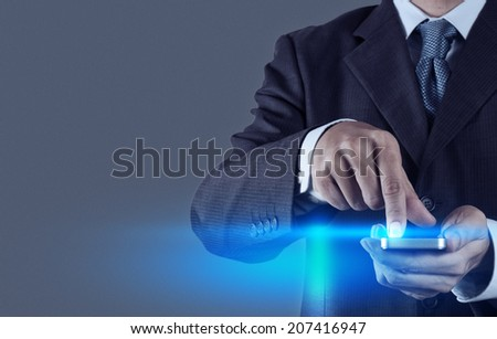 Businessman hand using mobile phone  as concept - stock photo