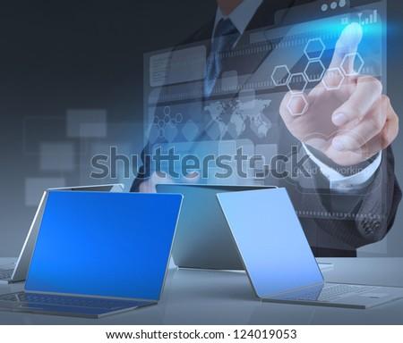 businessman hand working on modern technology - stock photo