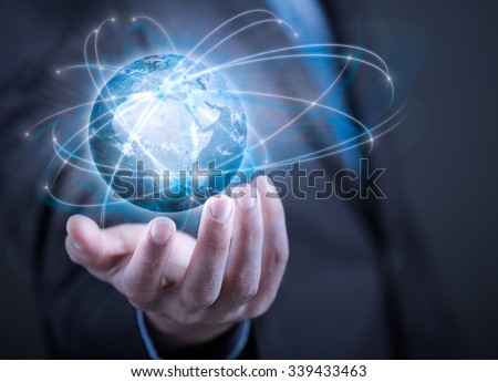 Businessman holding planet Earth in palm. Elements of this image are furnished by NASA - stock photo