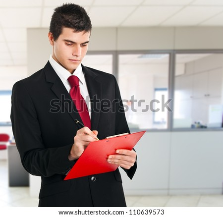 Businessman reading his agenda - stock photo