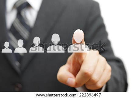Businessman touching virtual person. Promotion,staffing,career concept - stock photo