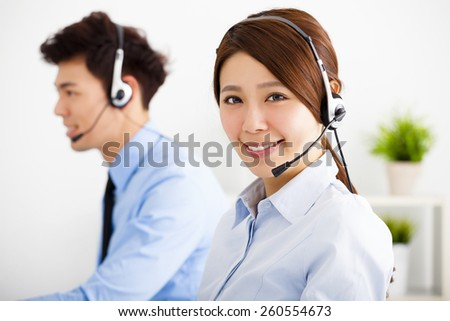 businesswoman and businessman with headset working in office - stock photo