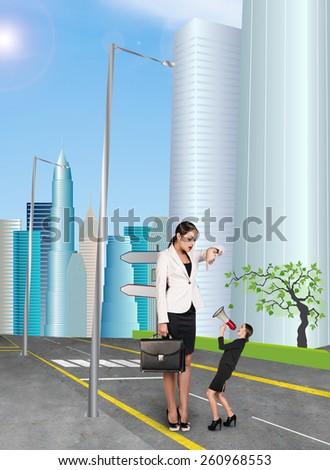 Businesswoman is big boss in city street - stock photo