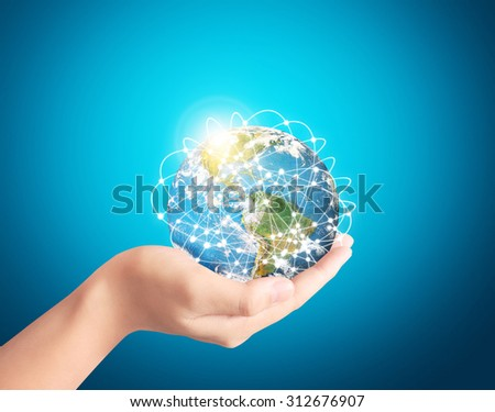 button on a touch screen interface in hand - stock photo