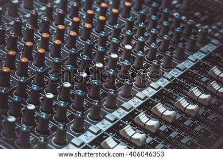 Buttons and tabs in various parts of the audio controller mixer ,music,mixer in studio,audio sound mixer with buttons and sliders - stock photo