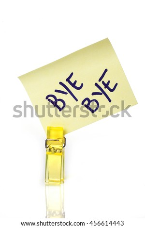 """""""Bye Bye"""" message written on a yellow paper note with a clothespins holding isolated over a white background - stock photo"""