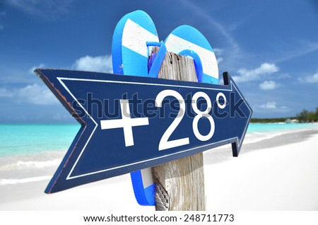 +28C arrow on the beach - stock photo