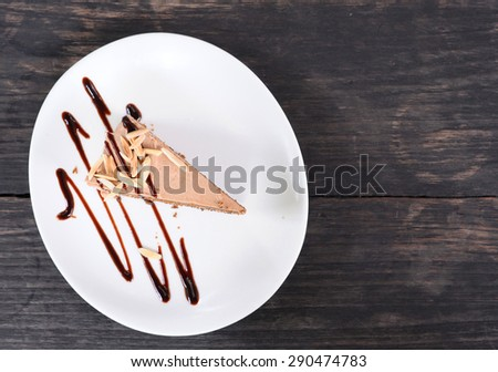 cake on old wooden table - stock photo