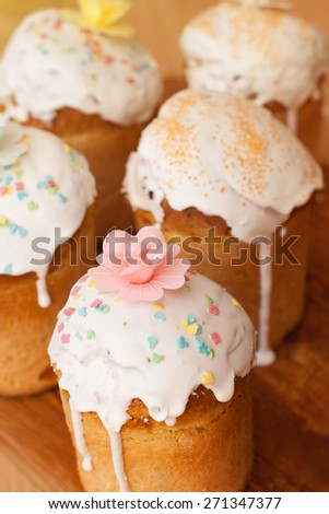 Cakes glazed with colored figures of animals and flower on top - stock photo