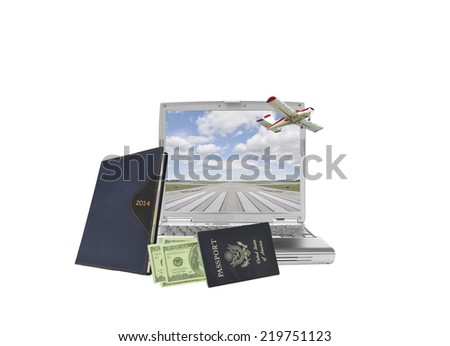 2014 Calendar Datebook with US passport filled with one hundred dollar bills and American currency leaning on laptop with heart shaped cloud blue sky isolated on white background - stock photo