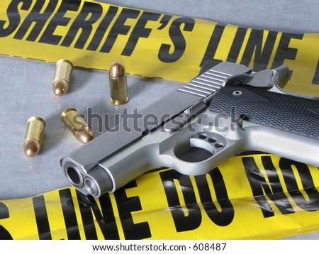 .45 caliber handgun at crime scene. - stock photo