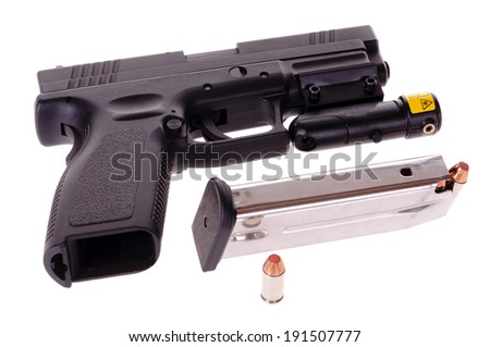 40 caliber semi-automatic handgun with a laser site attached - stock photo