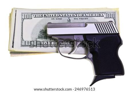 32 caliber stainless steel semi automatic pistol guarding American Money - stock photo
