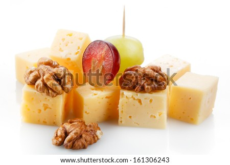 Canape with cheese, grape, olive and nuts. Macro - stock photo