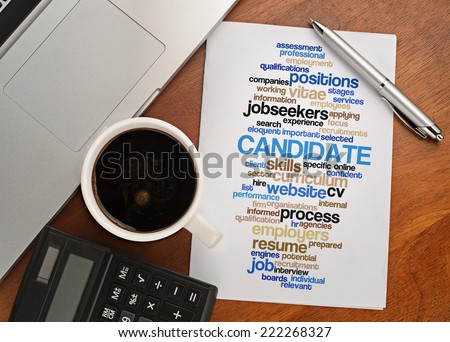 """CANDIDATE word cloud arrangement"" Notebook with text vision on table with coffee, calculator and notebook - stock photo"