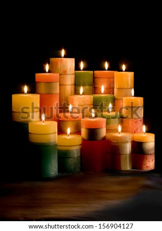 Candlelight on black background. Candle design for spa.Cylinder shape. - stock photo