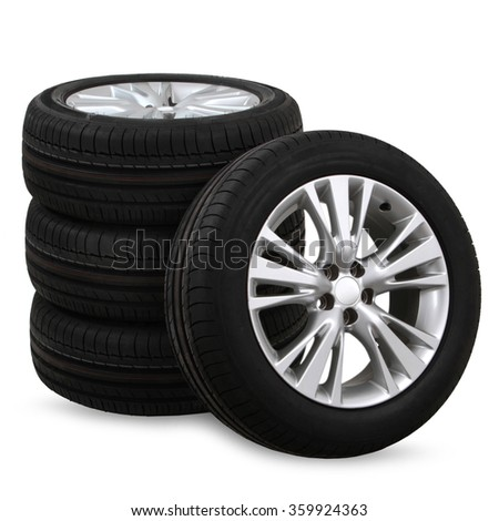4 car tires on a white background - stock photo