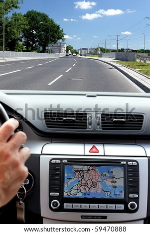 Car, windscreen and dashboard with gps display - stock photo