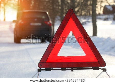 Car with a breakdown in the winter - stock photo