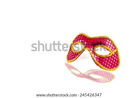 Carnival mask red floating on a white background with reflection effect. - stock photo