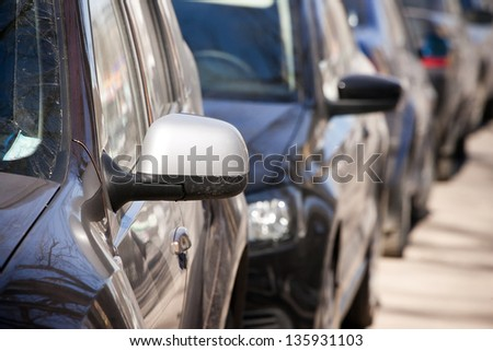 cars parked in parking lot - stock photo
