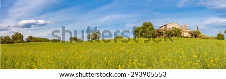 Catalan Farmhouse Panorama with spring fields in the foreground - stock photo