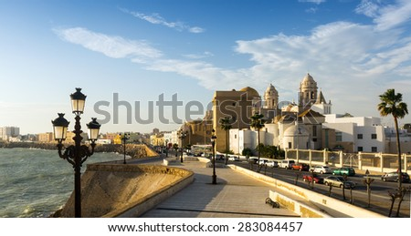 Cathedral and  embankment in  evening time. Cadiz, Spain  - stock photo