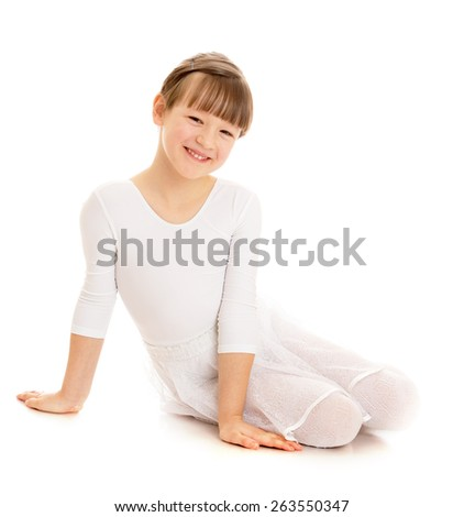 Caucasian little girl in a white bathing suit sitting on a gym floor. - isolated on white background - stock photo