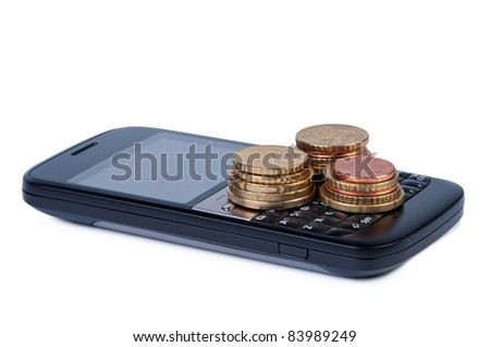 Cell phone with coins on white background shadow below. Concept of payment and savings. - stock photo