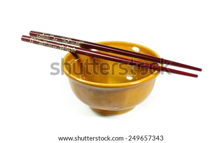 Ceramic bowl with wood traditions chopsticks Isolated on white background. - stock photo