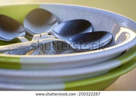 ceramic plates and cutlery - stock photo