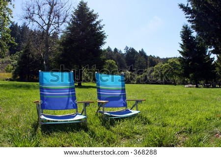 2 chairs in the park - stock photo