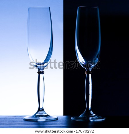 2 champagne glasses on black and light blue - stock photo