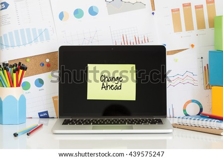 CHANGE AHEAD sticky note pasted on the laptop screen - stock photo