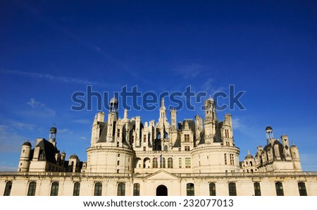 Chateau de Chambord in sunny day. (Val de Loire, France) - stock photo