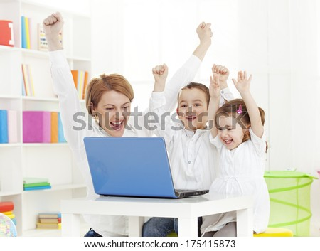 Cheering Family with a Computer - stock photo
