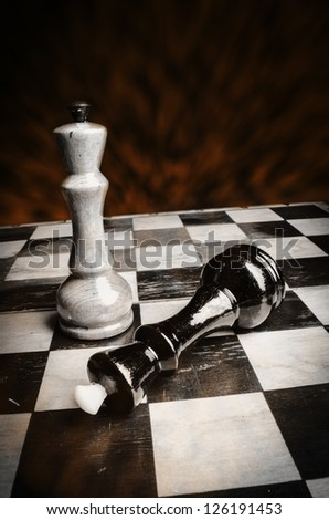Chess board black & white with dark awful background, win concept - stock photo