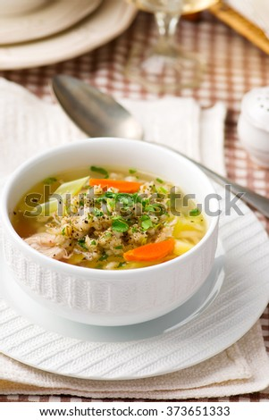 chicken soup with barley groat in a white bowl. style . selective focus - stock photo