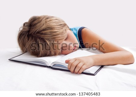 child sleeping with book - stock photo